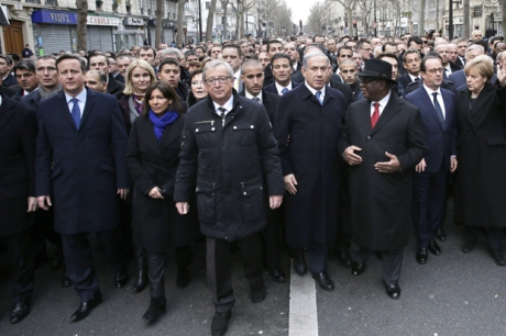 French President Francois Hollande (2nd R) is surrounded by heads of state including Britain's Prime Minister David Cameron (L), Paris Mayor Anne Hidalgo, EU Commission President Jean-Claude Juncker, Israel's Prime Minister Benjamin Netanyahu (4thR) Mali's President Ibrahim Boubacar Keita (3rdR) and Germany's Chancellor Angela Merkel (R) as they attend the solidarity march (Marche Republicaine) in the streets of Paris January 11, 2015. French citizens will be joined by dozens of foreign leaders, among them Arab and Muslim representatives, in a march on Sunday in an unprecedented tribute to this week's victims following the shootings by gunmen at the offices of the satirical weekly newspaper Charlie Hebdo, the killing of a police woman in Montrouge, and the hostage taking at a kosher supermarket at the Porte de Vincennes.     AFP PHOTO POOL PHILIPPE WOJAZER        (Photo credit should read PHILIPPE WOJAZER/AFP/Getty Images)