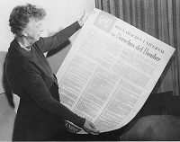 Eleanor Roosevelt with the Spanish version of the Universal Declaration of Human Rights