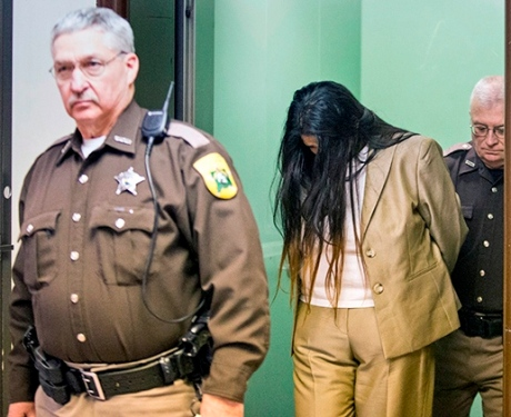 Purvi Patel is led out of the courtroom in handcuffs after being found guilty of felony neglect and feticide on Tuesday, Feb. 3, 2015, inside the St. Joseph County Courthouse in South Bend.