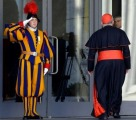 Swiss Guard saluting a Cardinal