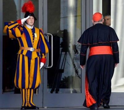 Swiss Guard saluting a  Novus Ordo Cardinal