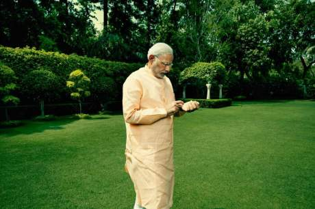 Prime Minister Narendra Modi in the garden at his official residence in New Delhi, India. May 2, 2015 CREDIT BELOW: Peter Hapak for TIME Mag a caption: AT HOME: The Indian Prime Minister takes a stroll through the gardens at his official residence in New Delhi