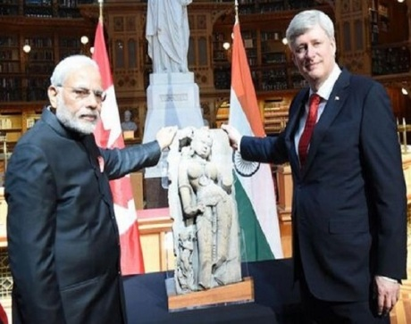 Narendra Modi, Stephen Harper, and 'Parrot Lady' sculpture