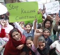 People from the Christian community attend a protest to condemn suicide bombings which took place outside two churches in Lahore