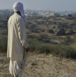 Rakhigarhi resident looks over ancient site