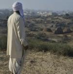 Rakhigarhi resident looks over ancient site