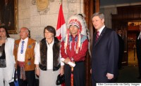 Canadian Prime Minister Stephen Harper (R) and National Chief of the Assembly of First Nations Phil Fontaine (2R) pause before walking into the House of Commons on Parliament Hill June 11, 2008 in Ottawa, Canada. Harper delivered a formal statement of apology on behalf of the Federal Government and all Canadians to former students of Indian Residential Schools, who for decades were forcibly removed from their communities and sent to state-funded schools to be assimilated. (Photo by Mike Carroccetto/Getty Images)