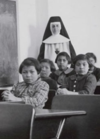 Female students and a nun at Cross Lake Indian Residential School in Cross Lake, Manitoba.