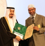 "Faisal Foundation on March 1, 2015 shows Saudi King Salman bin Abdul Aziz (L) presenting Zakir Naik, president of the Islamic Research Foundation in India, with the 2015 King Faisal International Prize for Service to Islam in Riyadh. Naik was honoured for being one of the most renowned non-Arabic speaking promoters of Islam. He founded the Peace TV channel, billed as the world's only channel specialising in comparative religion. AFP PHOTO / HO / King Faisal Foundation == RESTRICTED TO EDITORIAL USE - MANDATORY CREDIT ""AFP PHOTO / HO / King Faisal Foundation"" - NO MARKETING NO ADVERTISING CAMPAIGNS - DISTRIBUTED AS A SERVICE TO CLIENTS =="