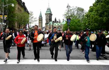 Drummers pass Parliament Hill as they lead the Walk for Reconciliation, part of the closing events of the Truth and Reconciliation Commission on Sunday, May 31, 2015 in Ottawa. Beginning in the 1870s, over 150,000 First Nations, Metis and Inuit children were required to attend government-funded, church-run residential schools in an attempt to assimilate them into Canadian society; the last school closed in 1996. Students were prohibited from speaking their own languages, practicing their culture and often experienced physical and sexual abuse. THE CANADIAN PRESS/Justin Tang