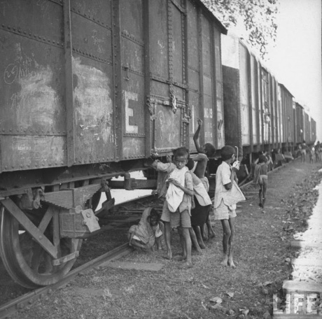 Bendal Famine 1943: Boys try to access rail-cars loaded with grain for export to UK.