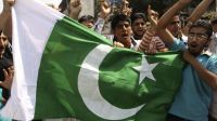 Pakistan's national flag displayed by Muslim youth in Kashmir
