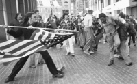 Roxbury, Boston 1974: Black student about to be stabbed with US flag pole.