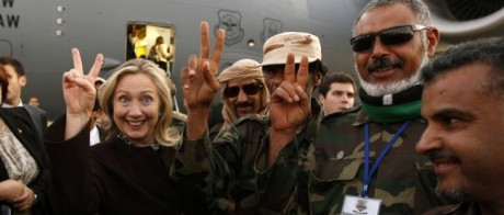 Clinton celebrating the end of Gaddafi with Libyan rebels