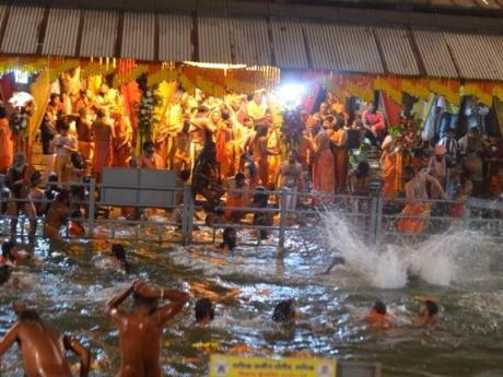 Sadhus bathing at Nashik Kumbha Mela 2015