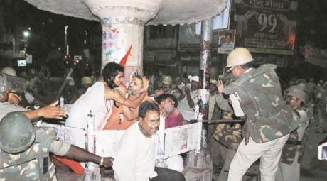 Varanasi: Police lathi-charge members of Sri Kashi Maratha Ganesha Utsav Samiti who were staging a dharna after they were prevented from immersing idols in Ganga river,.