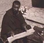 Tibetan monk holding scrolls