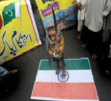 India flag desecrated in Pakistan by baby jihadi.