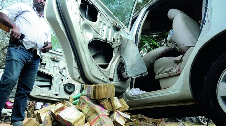 Hawala Cash : Police recover currency notes worth rupees 25 cr from a car that was hit by a bus near Coimbatore in January 2015