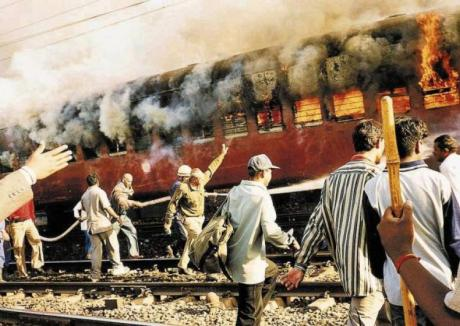 Sabarmati Express coach S-6 burning at Godhra railway station on 27 February 2002