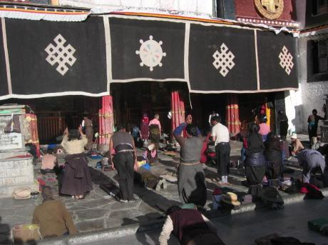 Pilgrims prostrating before the Jokhang Temple, Lhasa