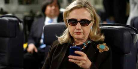 In this Oct. 18, 2011, file photo, then-Secretary of State Hillary Rodham Clinton checks her Blackberry from a desk inside a C-17 military plane upon her departure from Malta, in the Mediterranean Sea, bound for Tripoli, Libya. Clinton insists that if she pursues the presidency again, it will be different this time around. But revelations that she sidestepped the government email system as secretary of state suggest she may have a long way to go in making good on that promise. (AP Photo/Kevin Lamarque, Pool, File)