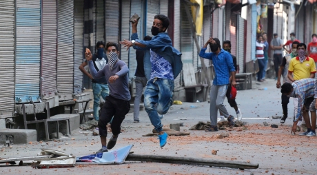 Young Kashmiri Muslim protesters throw stones at Indian policemen during clashes in Srinagar, the summer capital of Indian Kashmir, 11 July 2016. Clashes between civilians and police in India's northern region of Kashmir has spiked to at least 16 in the third day of violent unrest that has engulfed the Valley since the funeral of famed separatist militant Burhan Muzaffar Wani on 09 July. A curfew remains in place in many parts of the city, forbidding people from leaving their houses at any point during the day.