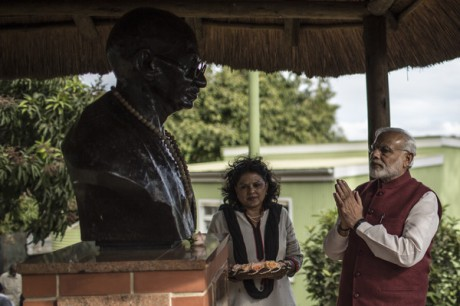 Indian Prime Minister Narendra Modi sets flowers at the bust of Mahatma Gandhi next to Gandhi's granddaughter Ela Gandhi at the Gandhi settlement in Phoenix, Durban, South Africa on July 9, 2016.