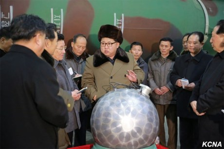 Kim Jong Un with what North Korea claims is a miniaturized silver spherical nuclear bomb (2016)
