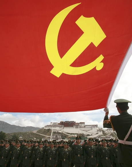 Policemen review the oath that they took when they joined the Communist Party of China (CPC) in front of Potala Palace in Lhasa
