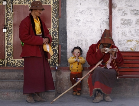 Tibetan family outside the Jokhang Temple in Lhasa, Tibet