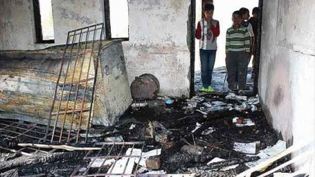 Burned-out school in Kashmir