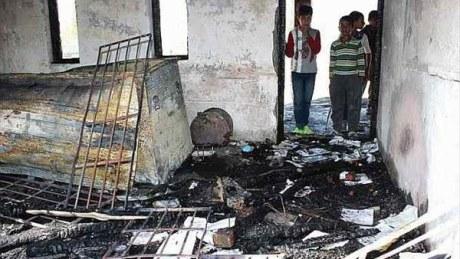 Burned-out school in Kashmir