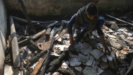 Kashmiri boy in burned-out school