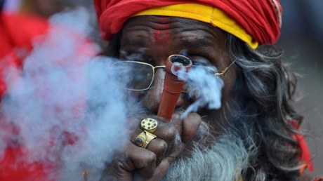 Sadhu smoking a chillum