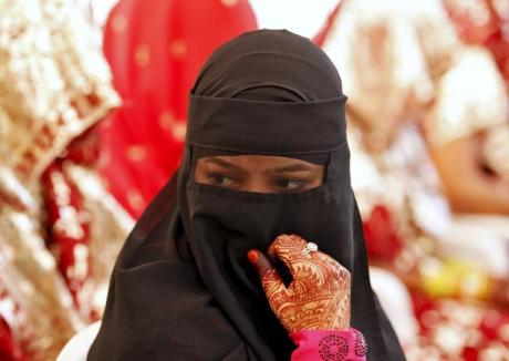 A Muslim bride waits for the start of a marriage ceremony in Ahmedabad
