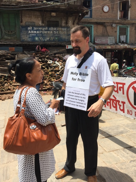 A Swiss missionary talks to a Nepali woman about the Bible in Kathmandu