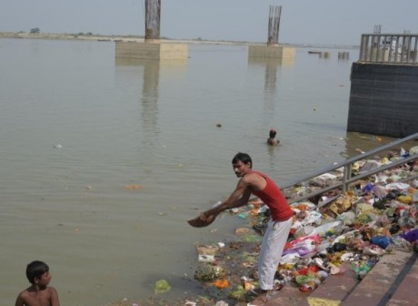 Ganga ghat steps strewn with garbage.