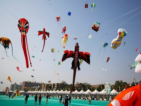 Enthusiasts flying kites various shapes of kites on the second day of International Kite Festival, in Ahmedabad on Monday (2018).