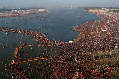 Sadhus and devotees take bath at Sangam (2019)