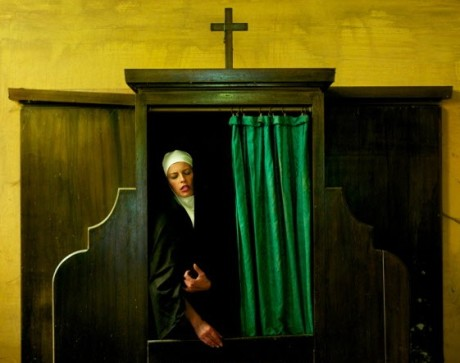 Nun in confessional booth