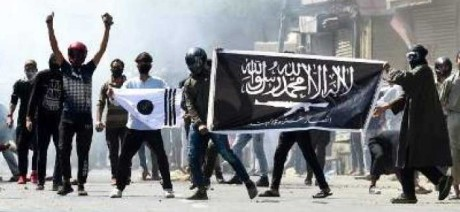 Kashmiri youth displaying ISIS flags in Srinagar