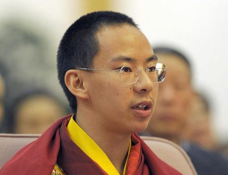 Chinese appointed Panchen Lama, Gyaincain Norbu attends at a symposium marking 50th anniversary on the liberation of Tibetan slaves at the Great Hall of the People in Beijing on 27 March 2009.