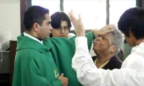 Catholic faith healing by the laying on of hands.