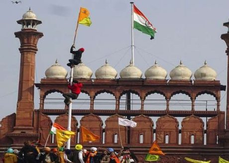 Rioters raise Sikh flag at Delhi's Red Fort (Jan. 26, 2021).