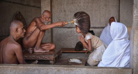 Jain muni blessing school girl.