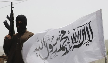 Taliban fighter with flag.